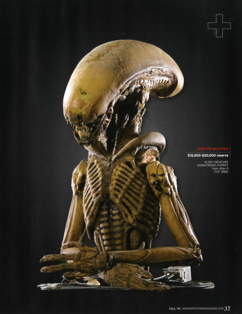 "magazine with ""alien creature"" figurine in color."