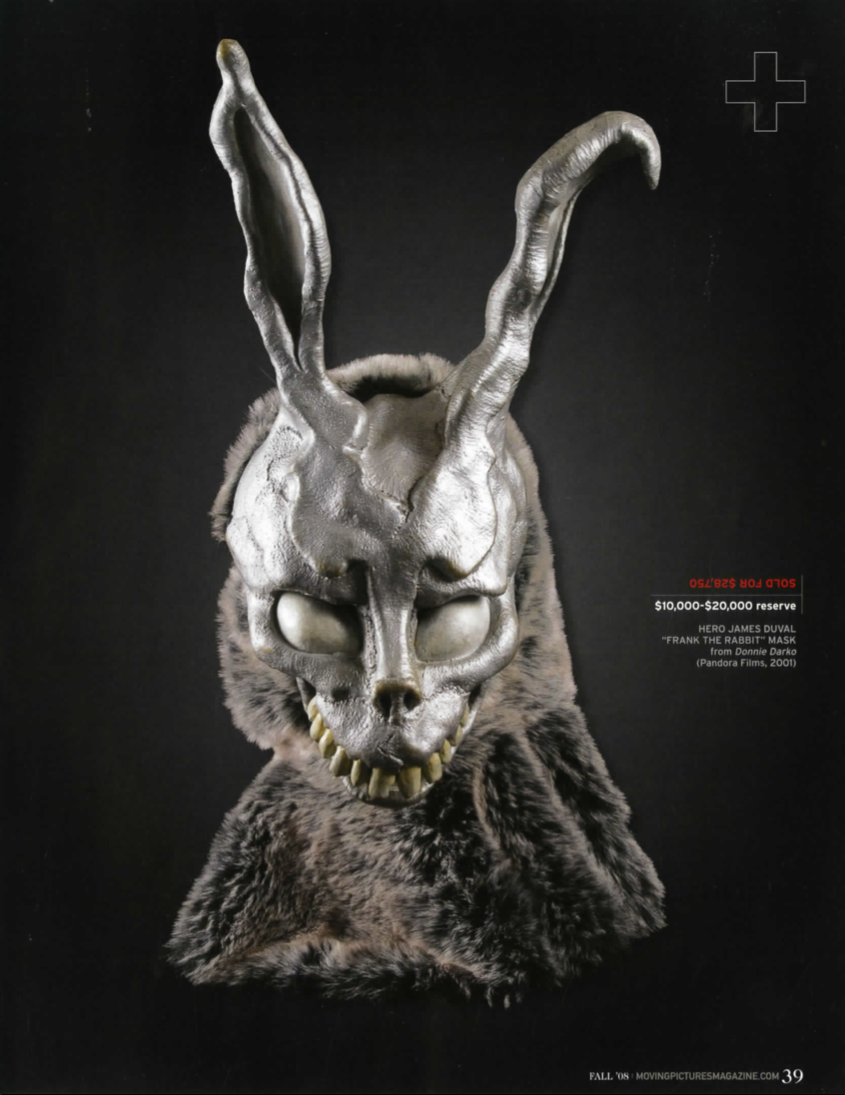 magazine article with creepy bunny figurine in grey, against a black background